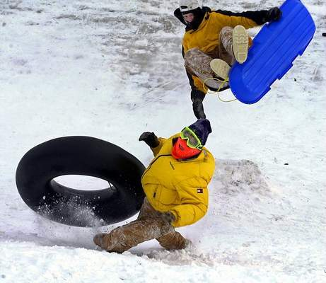 Dec. 18, 2000: Parenal Willcutts, top, and Zach Till, bottom, spend a day out of school in midair while hitting the slopes at Franke Park. (Journal Gazette file photo)