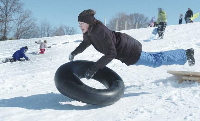 Feb. 25, 2011: Genevieve Reith, 13, loses her inner tube after hitting a snow ramp while sledding at Shoaff Park. (Journal Gazette file photo)