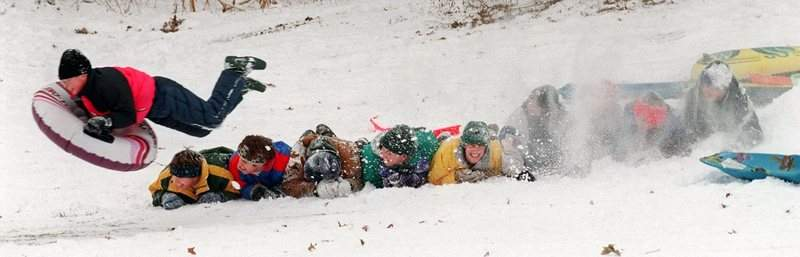 Dec. 19, 1995: Matt Koehlinger, 11, flies over nine kids after hitting a snow mound while sledding at Shoaff Park. Probably best not to try this one at home! (Journal Gazette file photo)