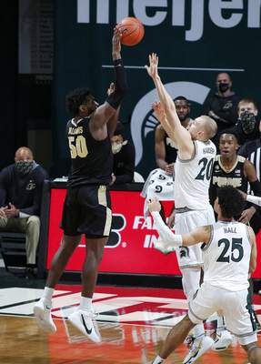 Associated Press Purdue's Trevion Williams shoots the go-ahead basket against Michigan State's Joey Hauser during Friday's Big Ten game in East Lansing, Mich.