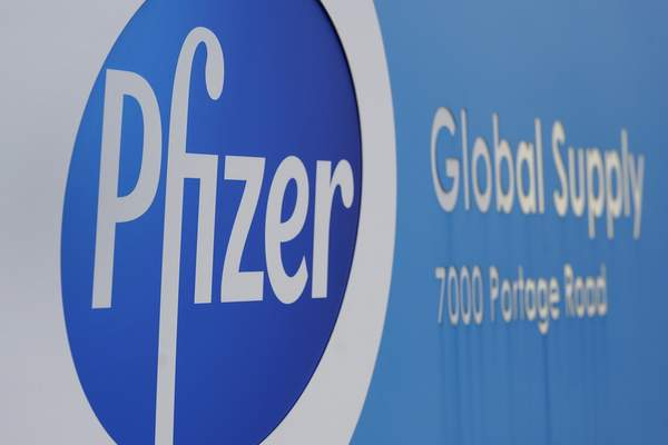 FILE - In this Friday, Dec. 11, 2020, file photo, a Pfizer Global Supply Kalamazoo manufacturing plant sign is shown in Portage, Mich. New research suggests that Pfizer's COVID-19 vaccine can protect against a mutation found in two contagious variants of the coronavirus that erupted in Britain and South Africa. Those variants are causing global concern. They both share a common mutation called N501Y, a slight alteration on one spot of the spike protein that coats the virus and is believed to be the reason they can spread so easily. (AP Photo/Paul Sancya, File)