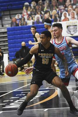 Katie Fyfe | The Journal Gazette  PFW Jalon Pipkins drives the ball to the basket durinig the second half against UIC at the Gates Sports Center on Saturday.