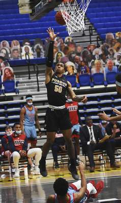 Katie Fyfe | The Journal Gazette  PFW Jalon Pipkins takes a shot durinig the first half against UIC at the Gates Sports Center on Saturday.
