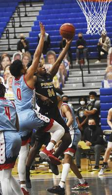 Katie Fyfe | The Journal Gazette  PFW senior Demierre Black takes a shot while UIC sophomore Brian Taylor defends him during the second half atthe Gates Sports Center on Saturday.
