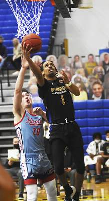 Katie Fyfe | The Journal Gazette Purdue Fort Wayne's Jarred Godfrey takes a shot in front of Illinois Chicago's Jamie Ahale on Saturday.