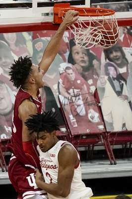 Indiana's Trayce Jackson-Davis dunks over Wisconsin's Aleem Ford during the second half of an NCAA college basketball game Thursday, Jan. 7, 2021, in Madison, Wis. (AP Photo/Morry Gash)