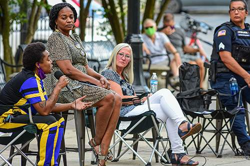 File  An AVOW-sponsored conversation on policing practices took place at the Barr Street Market in August 2020.
