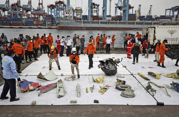 Parts of aircrafts found on the waters off Java Island where a Sriwijaya Air passenger jet crashed are laid out for inspection, at Tanjung Priok Port in Jakarta, Indonesia, Monday, Jan. 11, 2021. (AP Photo/Dita Alangkara)