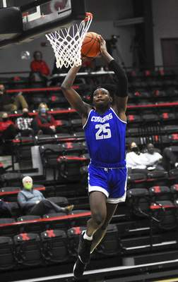 Katie Fyfe | The Journal Gazette  Saint Francis sophomore David Ejah takes a shot during the first half against Grace College at Manahan Orthopaedic Capital Center on Monday.