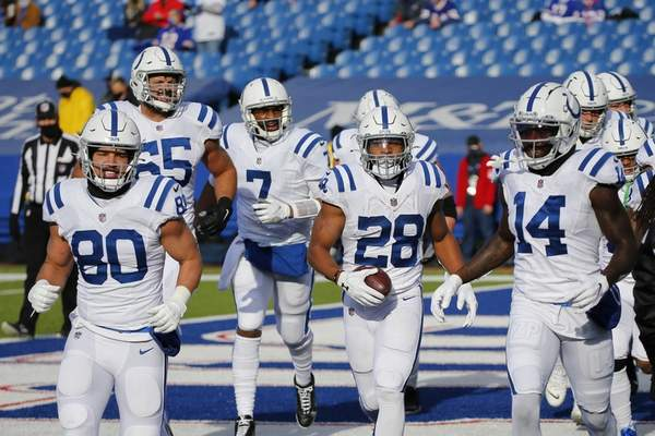 Associated Press Colts running back Jonathan Taylor, center with ball, celebrates with teammates after scoring a touchdown in Saturday's playoff loss to Buffalo.