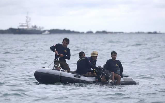 Indonesian Navy divers continue their search for wreckage of the crashed Sriwijaya Air passenger jet in the Java Sea, near Jakarta, Indonesia, Tuesday, Jan. 12, 2021. (AP Photo/Tatan Syuflana)