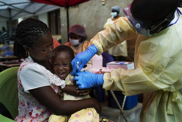 FILE - In this Saturday, July 13, 2019 file photo, a child is vaccinated against Ebola in Beni, Congo. (AP Photo/Jerome Delay, file)