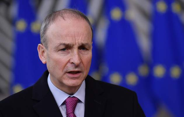 FILE - In this file photo dated Thursday, Dec. 10, 2020, Ireland's Prime Minister Micheal Martin speaks as he arrives at the European Council building in Brussels. (John Thys/ Pool FILE via AP)