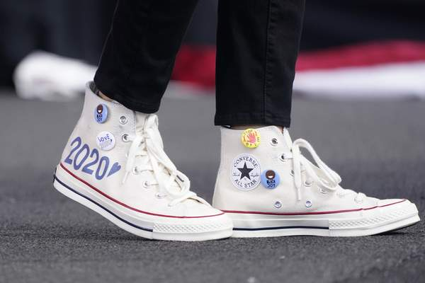 Converse high-top sneakers of Democratic vice presidential candidate Sen. Kamala Harris, D-Calif., are shown as she speaks at a drive-in early voting event, Saturday, Oct. 31, 2020, in Miami, Fla. (AP Photo/Wilfredo Lee, file)