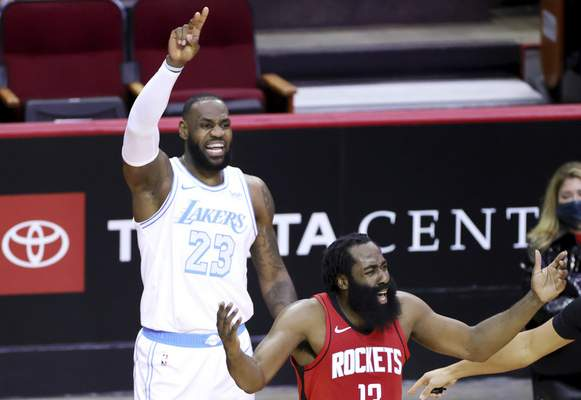 James Harden, right, of the Houston Rockets, reacts to a call ahead of LeBron James, left, of the Los Angeles Lakers during the first quarter of an NBA basketball game Sunday, Jan. 10, 2021, in Houston, Texas. (Carmen Mandato/Pool Photo via AP)