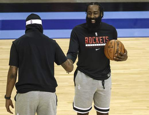 Houston Rockets guard James Harden, right, talks with Los Angeles Lakers forward Markieff Morris before an NBA basketball game Tuesday, Jan. 21, 2021, in Houston. (Troy Taormina/Pool Photo via AP)