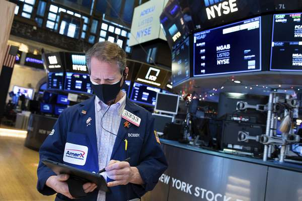 In this photo provided by the New York Stock Exchange, trader Robert Charmak works on the floor, Wednesday, Jan. 13, 2021, in New York. (Nicole Pereira/New York Stock Exchange via AP)