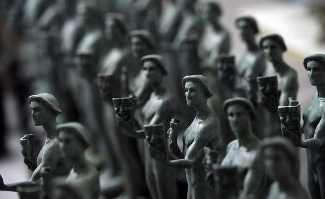 FILE - Finished Actor statuettes are displayed during the 25th annual Casting of the Screen Actors Guild Awards at American Fine Arts Foundry on Jan. 15, 2019, in Burbank, Calif. (Photo by Chris Pizzello/Invision/AP, File)