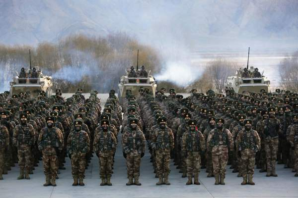 Chinese soldiers rally while training in -20 degrees Celsius (-4 Fahrenheit) conditions in Kashgar in northwestern China's Xinjiang Uighur Autonomous Region on Monday, Jan. 4, 2021. (Chinatopix Via AP)