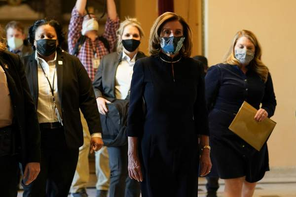 Speaker of the House Nancy Pelosi, D-Calif., walks to the House chamber to lead the final vote of the impeachment of President Donald Trump, for his role in inciting an angry mob to storm the Congress last week, at the Capitol in Washington, Wednesday, Jan. 13, 2021. (AP Photo/Susan Walsh)