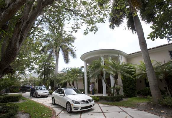 FILE - The exterior of a South Florida home that once belonged to 1970's heartthrob David Cassidy appears in Fort Lauderdale, Fla. on July 22, 2015. The home has been sold for $2.6 million. Cassidy rose to fame as a teen idol who starred in The Partridge Family. He died at age 67 in 2017. (AP Photo/Wilfredo Lee, File)