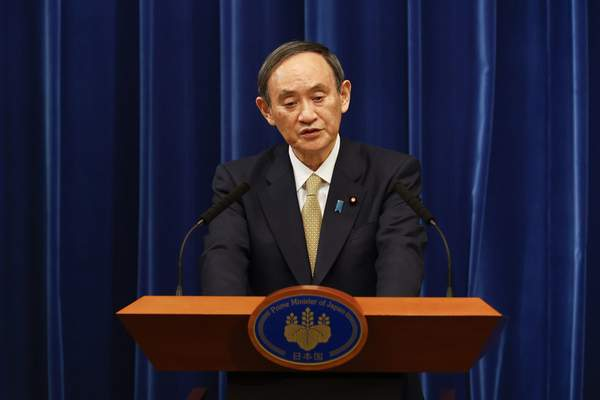 Japan's Prime Minister Yoshihide Suga speaks during a press conference at the prime minister's official residence Wednesday, Jan. 13, 2021, Tokyo, Japan. (Rodrigo Reyes Marin/Pool Photo via AP)