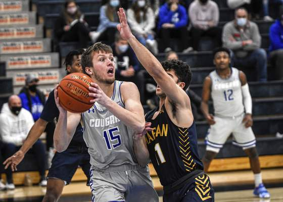 Mike Moore | The Journal Gazette Saint Francis guard Brayton Bailey looks for help in the first half against Marian at the Hutzell Athletic Center on Wednesday night.