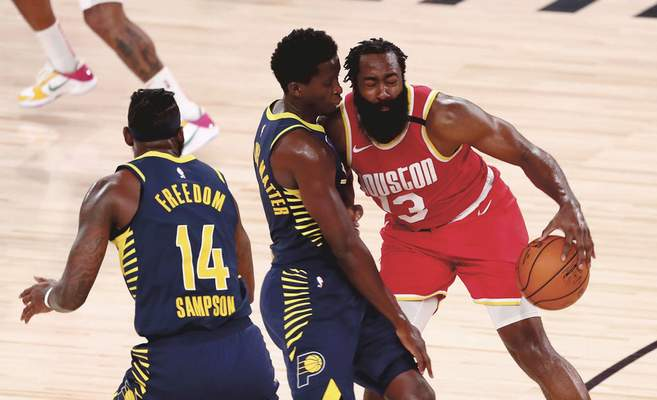 Associated Press The Pacers sent Victor Oladipo, left, to Houston as the Rockets moved James Harden to the Brooklyn Nets in a four-team trade.