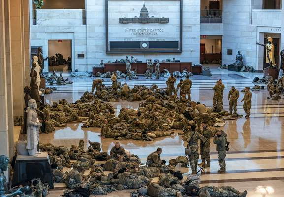 Associated Press  National Guard troops hold inside the Capitol visitors center to reinforce security Wednesday at the Capitol in Washington as the House of Representatives pursued an article of impeachment against President Donald Trump.