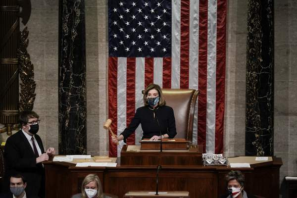 Associated Press Speaker of the House Nancy Pelosi, D-Calif., leads the final vote of the impeachment of President Donald Trump on Wednesday for his role in inciting an angry mob to storm the U.S. Capitol on Jan. 6