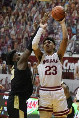 Indiana's Trayce Jackson-Davis (23) shoots over Purdue's Trevion Williams (50) during the second half of an NCAA college basketball game Thursday, Jan. 14, 2021, in Bloomington Ind. Purdue won 81-69. (AP Photo/Darron Cummings)