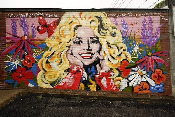 A mural of Dolly Parton is seen outside The 5 Spot, a music club in Nashville, Tenn., Friday, Aug. 21, 2020. Artist Kim Radford said Dolly fans from around the world have contacted her about the mural, which contains a quote from Parton about her support for the Black Lives Matter movement. (AP Photo/Mark Humphrey)