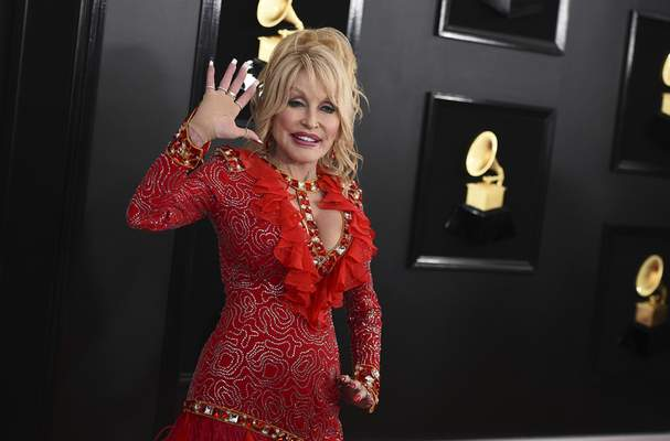 FILE - Dolly Parton arrives at the 61st annual Grammy Awards on Feb. 10, 2019, in Los Angeles. Parton turns 75 on Jan. 19. (Photo by Jordan Strauss/Invision/AP, File)