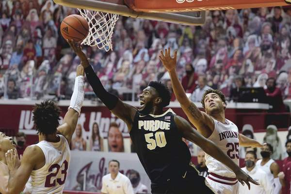 Associated Press Purdue's Trevion Williams shoots against Indiana's Trayce Jackson-Davis, left, and Race Thompson on Thursday night in Bloomington.