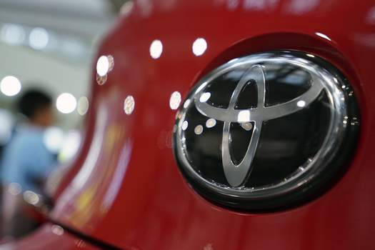 Toyota-Emissions Settlement Associated Pess Toyota will settle U.S. allegations that it failed to report pollution control system defects in its vehicles.  (Eugene HoshikoSTF)