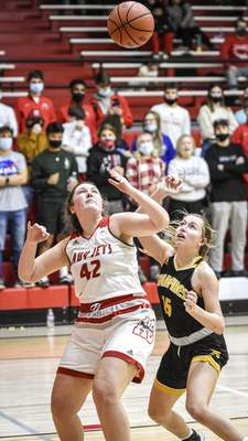 Mike Moore   The Journal Gazette Adams Central junior Kaitlyn Biberstine, left and South Adams freshman Macy Pries go for a rebound in the second period at Adams Central on Friday.