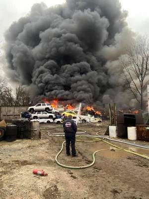 Courtesy/New Haven-Adams Township Fire Department  A fire at Stein Auto Salvage in New Haven was reported in the yard at 9:40 a.m. Flames reached 50 feet into the air.