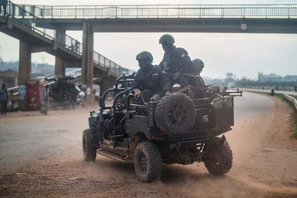 Security forces patrol the streets of Kampala, Uganda, Thursday, Jan. 14, 2021.Ugandans are voting in a presidential election tainted by widespread violence that some fear could escalate as security forces try to stop supporters of leading opposition challenger Bobi Wine from monitoring polling stations. (AP Photo/Jerome Delay)