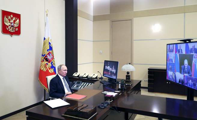 Russian President Vladimir Putin chairs a Security Council meeting via video conference at the Novo-Ogaryovo residence outside Moscow, Russia, Friday, Jan. 15, 2021. Russia announced Friday that it will withdraw from the Open Skies Treaty allowing observation flights over military facilities following the U.S. exit from the pact. (Mikhail Klimentyev, Sputnik, Kremlin Pool Photo via AP)