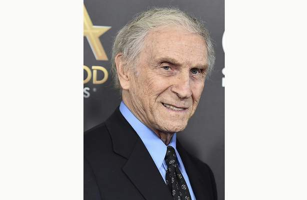 "FILE - In this Nov. 1, 2015, file photo, Peter Mark Richman arrives at the Hollywood Film Awards in Beverly Hills, Calif. Richman, a character actor who appeared in hundreds of television episodes and had recurring roles on ""Three's Company and ""Beverly Hills 90210, has died. He was 93. Richman died Thursday, Jan. 14, 2021, at his home in Los Angeles of natural causes, publicist Harlan Boll announced. (Photo by Jordan Strauss/Invision/AP, File)"