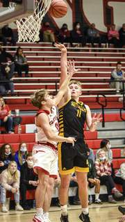 Mike Moore   The Journal Gazette South Adams senior James Arnold takes a shot against an Adams Central defender Friday night. Arnold finished with 27 points.