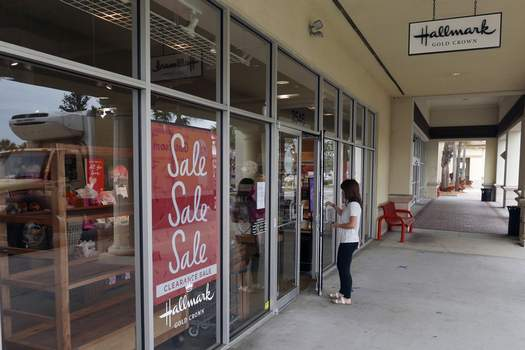 Retail Sales Associated Press A sale sign is displayed near the entrance of a Hallmark store Tuesday in Orlando, Fla. Retail sales fell for a third straight month, as a surge in virus cases kept people away. (John RaouxSTF)