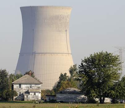 Bribery Investigation Ohio Associated Press The Davis-Besse Nuclear Power Station looms over an adjacent farm in Oak Harbor, Ohio. The town is reliant on taxes paid by the plant, which is in danger of closing. (Amy SancettaSTF)