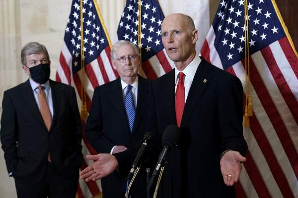 In this Nov. 10, 2020, file photo Sen. Rick Scott, R-Fla., joined at center by Senate Majority Leader Mitch McConnell, R-Ky., and Sen. Roy Blunt, R-Mo., far left, speaks to reporters briefly following a closed-door meeting where the Republican Conference held leadership elections, on Capitol Hill in Washington. (AP Photo/J. Scott Applewhite, File)