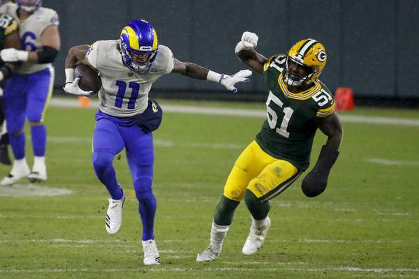 Los Angeles Rams' Josh Reynolds breaks away from Green Bay Packers' Krys Barnes during the first half of an NFL divisional playoff football game, Saturday, Jan. 16, 2021, in Green Bay, Wis. (AP Photo/Mike Roemer)