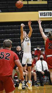 Mike Moore | The Journal Gazette South Adams junior Aidan Wanner takes a shot at the basket in the second period against Bluffton on Saturday.
