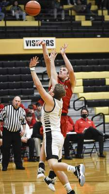 Mike Moore   The Journal Gazette Bluffton Senior Hayden Nern takes a shot at the basket in the third period against South Adams on Saturday.