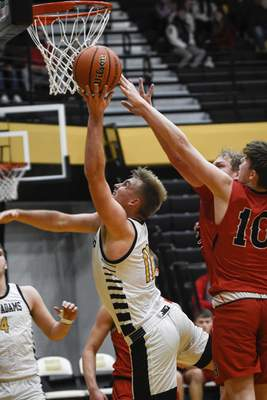 Mike Moore   The Journal Gazette South Adams senior James Arnold attacks the basket in the second period against Bluffton on Saturday.