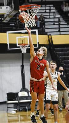 Mike Moore   The Journal Gazette Bluffton junior Max Stoppenhagen scores a layup in the third period against South Adams on Saturday.