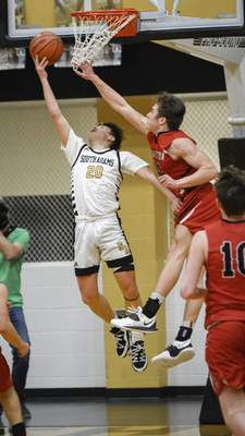 Mike Moore   The Journal Gazette South Adams junior Trey Schoch scores a reverse layup on Saturday in the third period against Bluffton on Saturday.